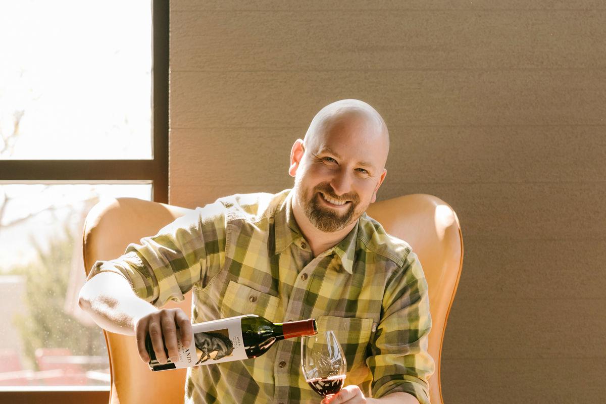 winemaker holding wine