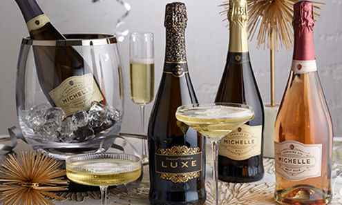 Sparkling wine bottles and glasses on festive table